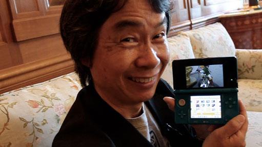 Shigeru Miyamoto with a Nintendo 3DS