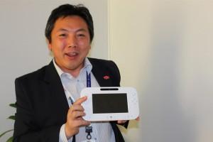 Katsuya Eguchi holding the Wii U controller